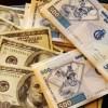 Le taux du dollar baisse pour la première fois depuis près d'une année