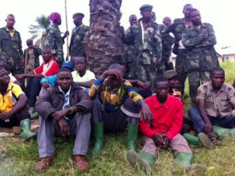 26 membres du M23 à la base militaire de Rutshuru qui se sont rendus. Tous sont congolais et disent avoir été enrôlés de force. «Le M23 faisait la loi ici nous n'avions pas d'autres choix que de travailler avec eux». RFI/Léa-Lisa Westerhoff