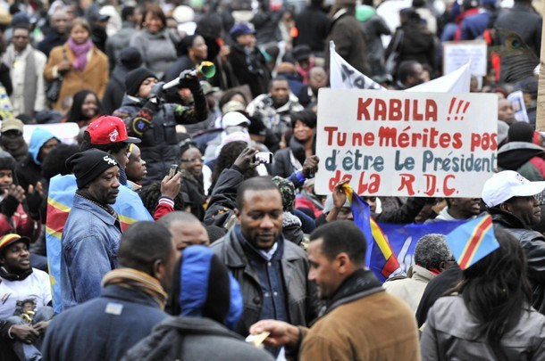 Congolese immigrants shout slogans, and