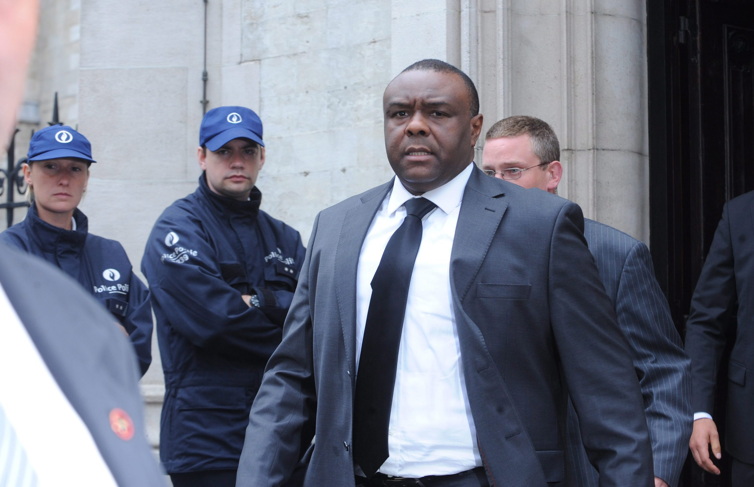 Congolese politician Jean-Pierre Bemba leaving the church after his father's funeral service.